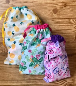three different sizes of drawstring bags.