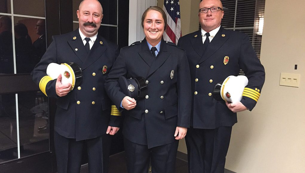 Chief Matt Roosa, firefighter Hanna Rollin, and Assistant Chief Chris Mullins.