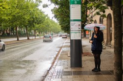Waiting for the bus in the rain.