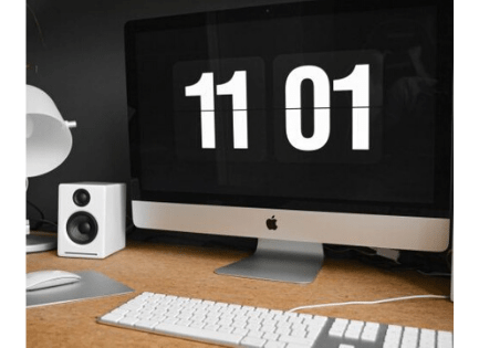 a macbook showing 11 01 to provide tips on how to structure your day as a freelancer