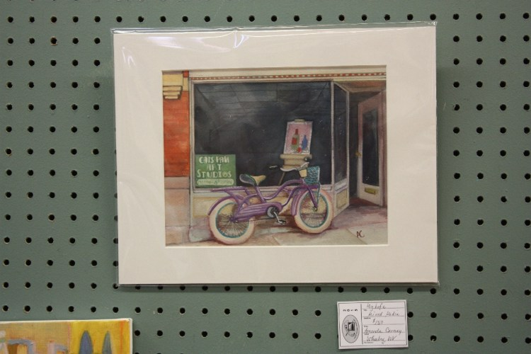 Amanda Carney's plein air painting of her bike and shop.