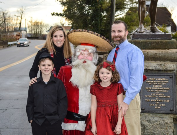 """The Ashmore family recently borrowed the """"Fiesta Santa"""" that once attracted customers to Reichart's in downtown Wheeling. for a family portrait. Ben is now nine years old, and Sammie is seven."""