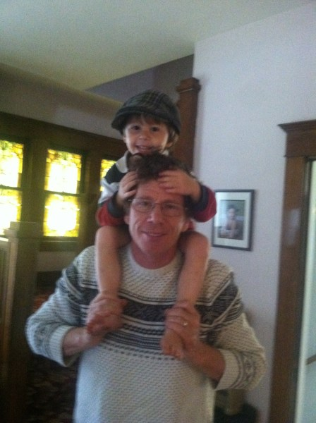Tristan on the shoulders of his father, Jim Greer.
