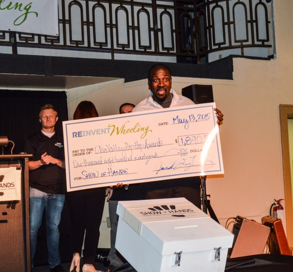 """Scott poses with the """"big check"""" worth $1,890 thanks to Orrick, Sutcliffe & Herrington and those who attended."""