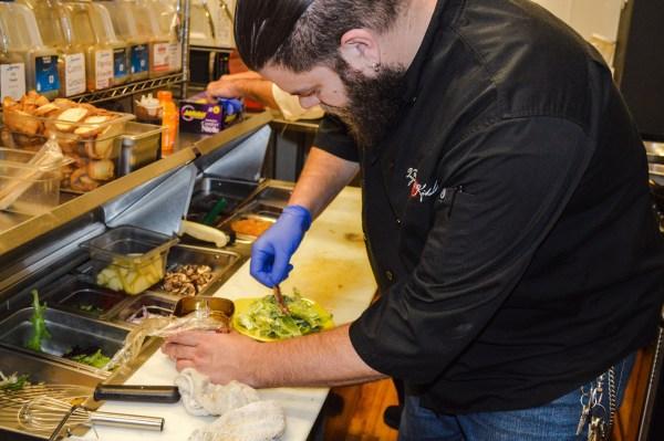 "The ""Vagabond Chef"" Matt Welsch prepares a Caesar Salad complete with anchovies."