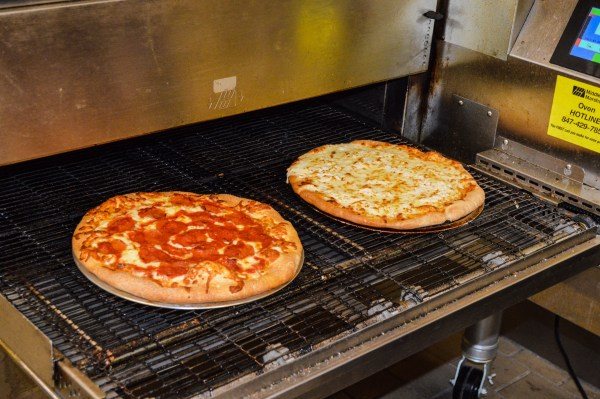 """Ten different pizzas, including the """"Chicago Pepperoni"""" and the """"White Sox,"""" a pie with parmesan, mozzarella, white cheddar, and ricotta cheese, and garlic butter."""