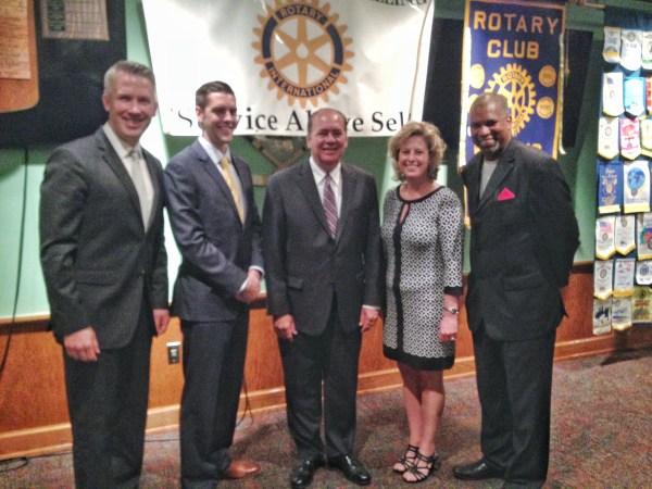 Elliott, seen here with Walker Holloway, W.Va. Gov. Earl Ray Tomblin, Danielle McCracken, and Rev. Darrell Cummins, is the treasurer for the Rotary Club of Wheeling.