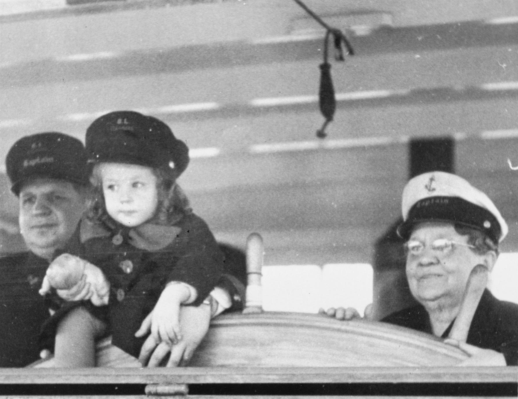 Capt. Mary and her son Capt. Tom holding his daughter Mary