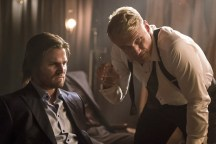 """Arrow -- """"So It Begins"""" -- Image AR506a_0233b.jpg -- Pictured (L-R): Stephen Amell as Oliver Queen and Dolph Lundgren as Konstantin Kovar -- Photo: Katie Yu/The CW -- © 2016 The CW Network, LLC. All Rights Reserved."""