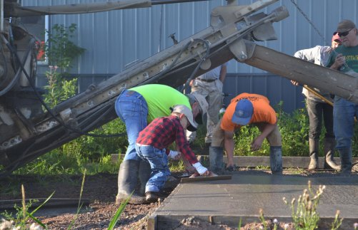 Pouring the slab at We Grow LLC