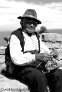 An old gentlemen of Taquile demonstrating his knitting skills