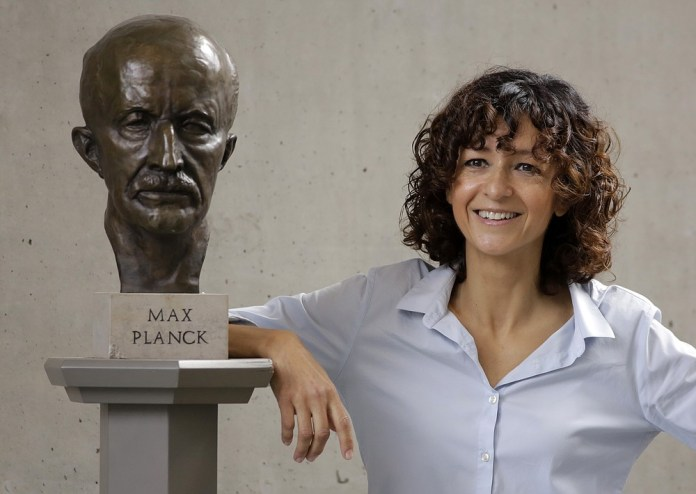 French microbiologist Emmanuelle Charpentier poses near a statue of Max Planck in Berlin, Germany on Wednesday, October 7, 2020. French scientist Emmanuelle Charpentier and American Jennifer A. Doudna won the 2020 Nobel Prize in Chemistry for developing a method of editing the genome assimilated to
