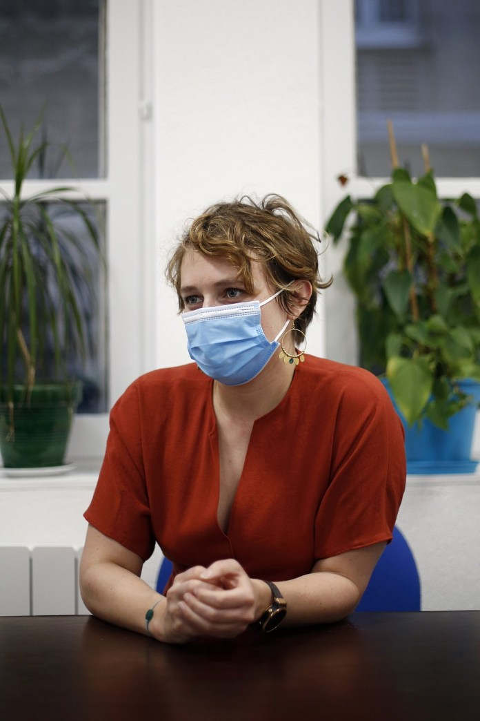 A director of a retirement home, Eve Guillaume, speaks during an interview in Paris, Wednesday, January 7, 2021. Guillaume says that obtaining the vaccination consent of his 64 residents, or their guardians and families when they aren't fit enough to get along, proving by far the most labor-intensive part of her preparations to start vaccinations later in January.  (AP Photo / Thibault Camus)