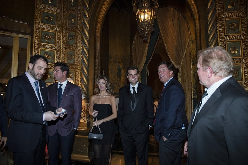 FILE - In this March 7, 2020, file photo, Rep. Matt Gaetz, R-Fla., fourth from right, and others stand before a dinner with President Donald Trump and Brazilian President Jair Bolsonaro at Mar-a-Lago in Palm Beach, Fla. (AP Photo/Alex Brandon, File)