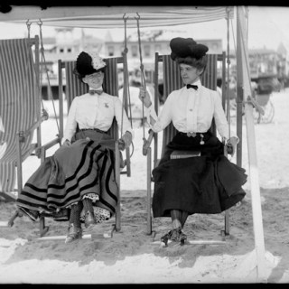Daring ladies on swinging deckchairs, 1905