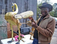 O.L. Samuels poses with his Lottery Flamingo