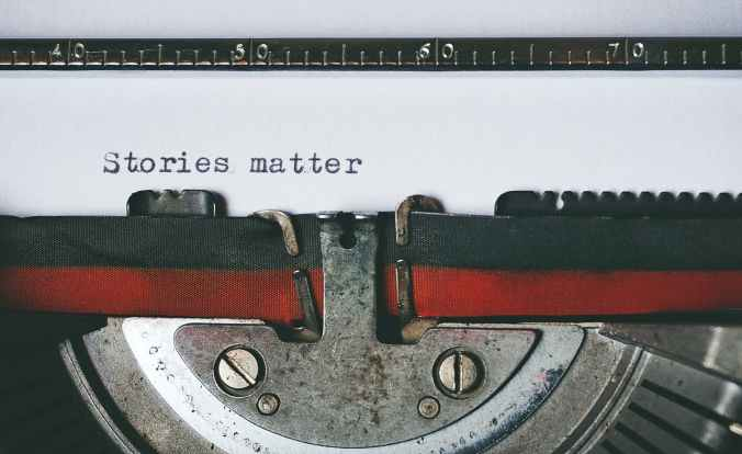 typewriter where on page is written that stories matter