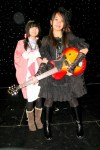 Gloria holds first prize, (Eriks guitar!) with Angel beside her.