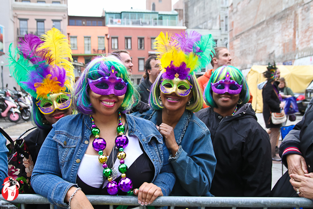Parade watchers getting into the spirit of Mardi Gras