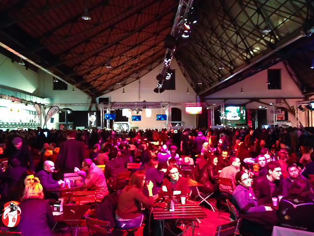 Festival goers enjoy the famous Belgium beer at the festival's indoor pub.