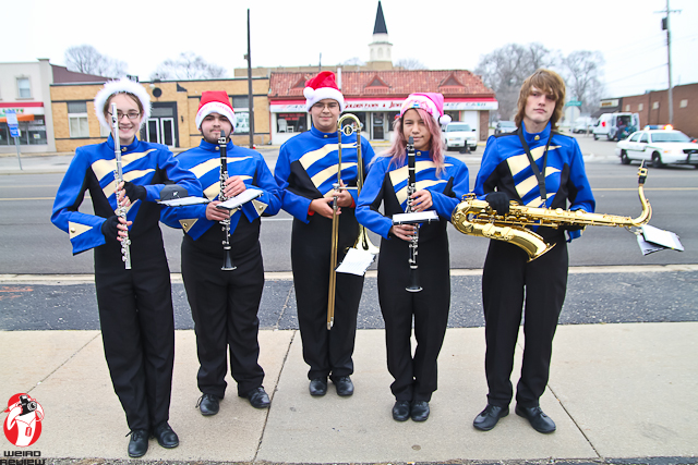 Members of the Godwin Marching Band relax after their performance