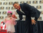 Jarrett Crippen helping a young zombie girl brave the stage at Wizard World New Orleans - photo by Brian Epstein