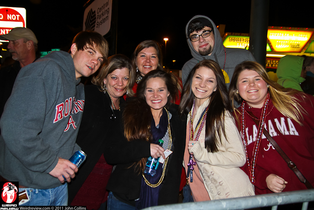 Folks along the sidelines smiled for the camera between the floats and bands