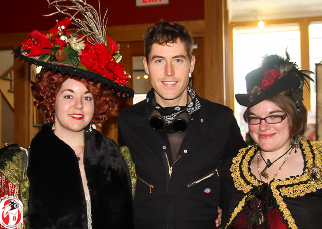 SPG's Michael Reed smiles sandwiched between a couple of the local lovelies