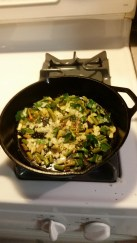 Greens cooking in cast iron skillet