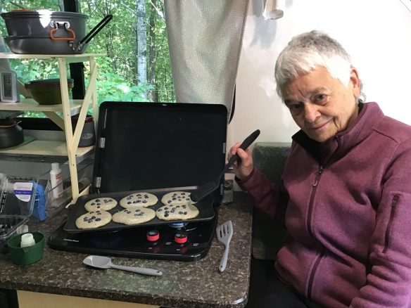 Cooking blueberry pancakes on our griddle.