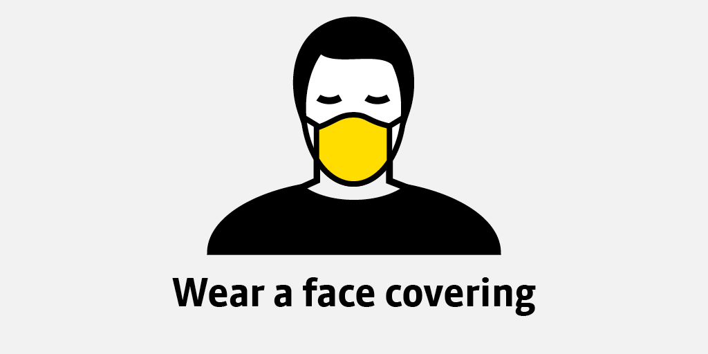 Transport for Greater Manchester image of person in face mask reading