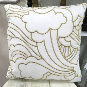Oh Joy! cloud pillow at Target. It is white with a gold design depicting clouds and rainbows.