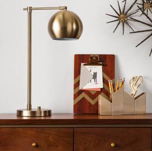 Target modern globe lamp shown on a credenza, next to a clipboard and pencil holder.