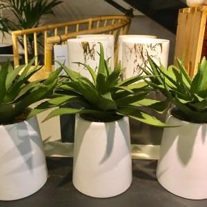 CB2 faux plant arrangement in a tall white pot.