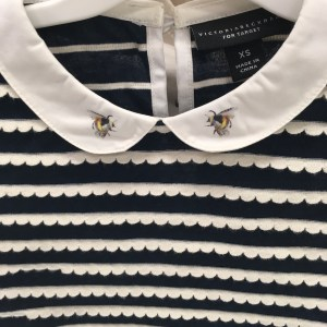 Victoria Beckham for Target review. Detail of black and white scalloped shirt and collar with a bee print on girls' outfit.