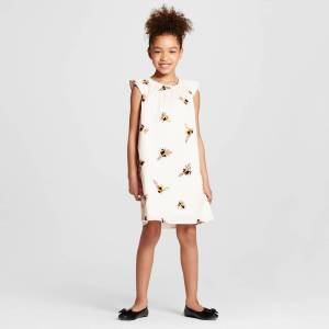 Victoria Beckham for Target girls bee print cap sleeve peasant dress, as shown on a little girl with black ballet flats.
