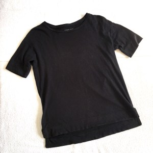 Everlane drop-shoulder tee, pictured laid flat.