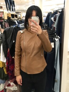 Trouve raw edge leather jacket in brown, as modeled zipped up on me. Selfie in a full-length mirror.