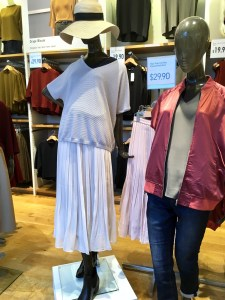 Uniqlo pleated skirt, as displayed on a mannequin in the store.