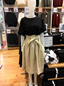Uniqlo high waist midi flare skirt as shown on a mannequin in the store.