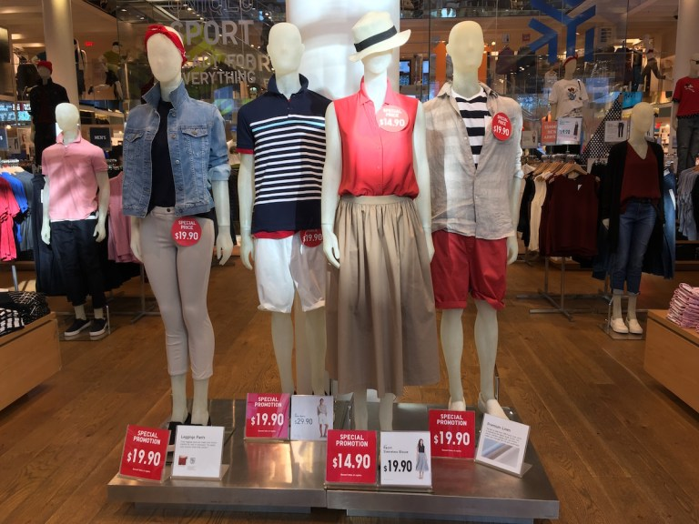 Uniqlo retail display of four mannequins in the summer light