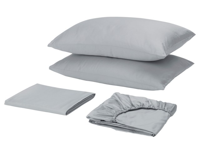 Two pillows, a folded flat sheet, and a folded fitted sheet in light gray.
