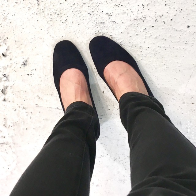 Everlane day heel in black, as seen worn, from above looking down at the shoes.