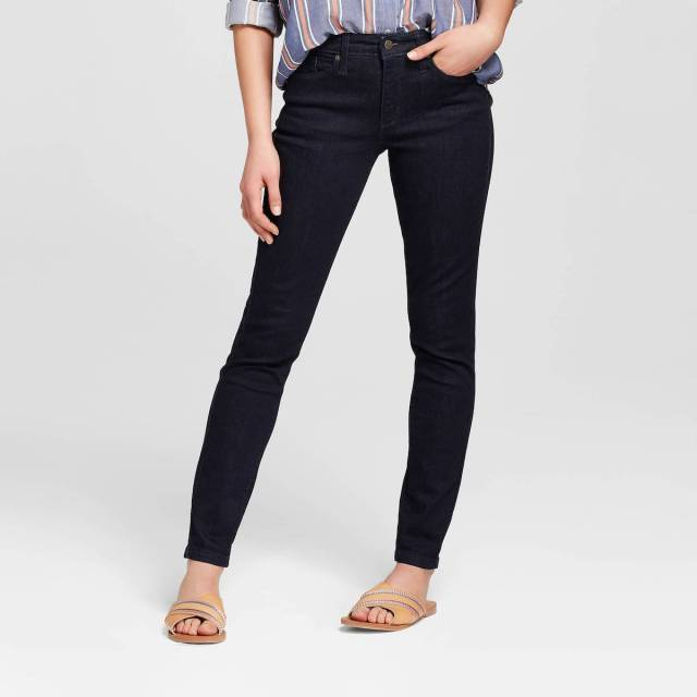 193b7f1b9741 A model wearing a pair of dark wash jeans. Only her legs are shown. Universal  Thread High-Rise Skinny ...