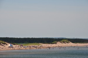 This is a photo of beach goers along Cavendish Beach