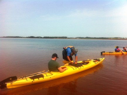 Paul showing Jordon the ropes of steering the kayaks