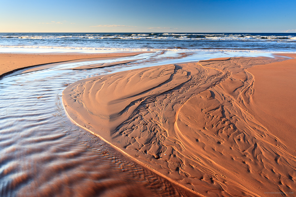 Patterns carved in the sand at Brackley Beach