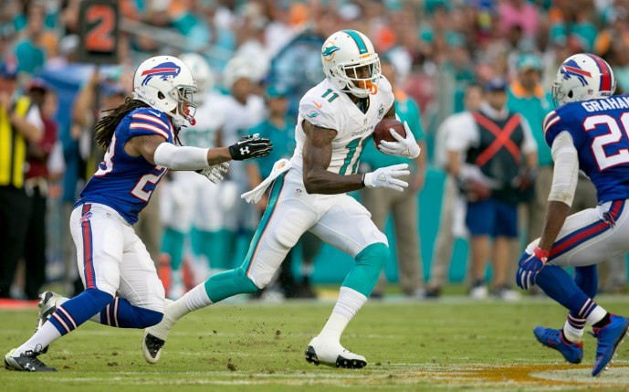 Miami Dolphins wide receiver DeVante Parker (11) makes a catch between Buffalo Bills cornerback Ronald Darby (28) and Buffalo Bills free safety Corey Graham (20) at Sun Life Stadium in Miami Gardens, Florida on September 27, 2015.  (Allen Eyestone / The Palm Beach Post)