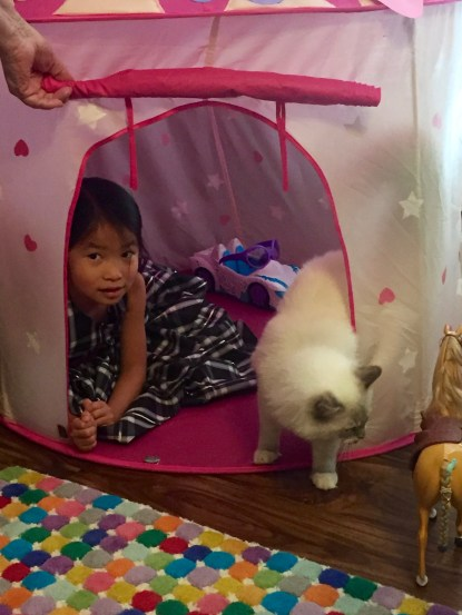 Reily visiting Nat in her playroom