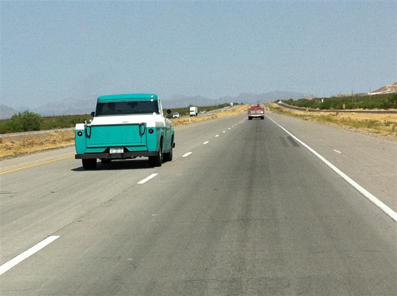 """A Road Tour member passing us. Neat, clean 1960 Ford truck. Front plate reads: """"Grandpa bought it, I've still got it."""""""